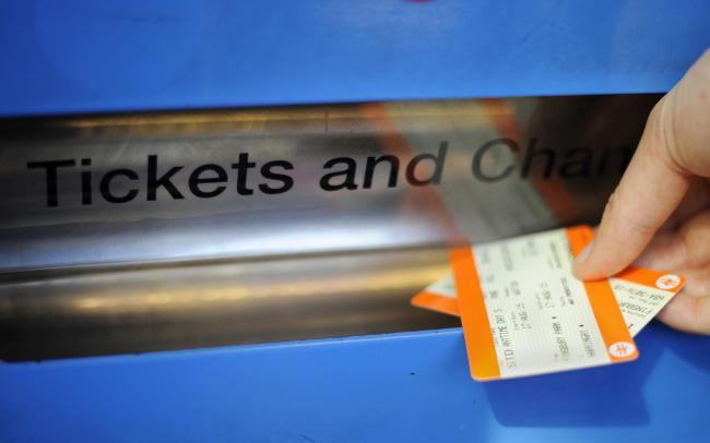 Embargoed to 0001 Wednesday August 14Undated file photo of a personbuying a train ticket at Finsbury Park station in London. Train commuters will