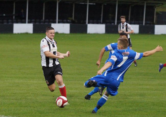 Action from Kendal Town Reserves' clash v Lancaster City
