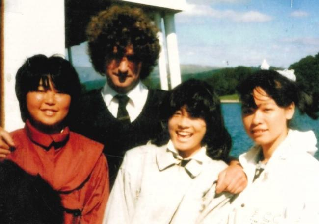 Philip Ridley pictured with tourists from Osaka, Japan, in the 1970s, on board Windermere Lake Cruises, where he worked