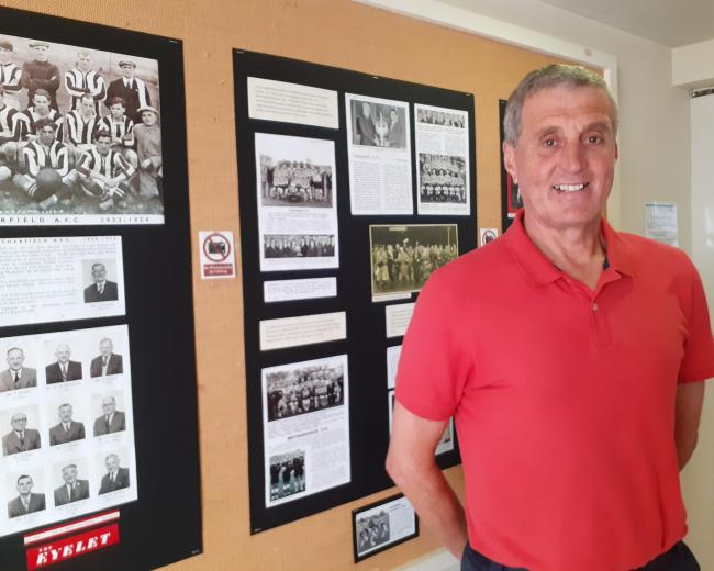 Former player Peter McDonnell views the centenary exhibition