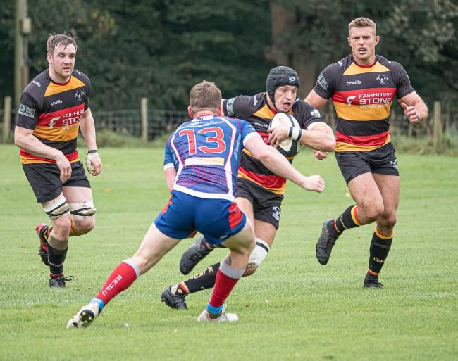Kirkby Lonsdale's Mike Fearon makes ground against Blackburn, supported by Alex Rogers and Scott Armstrong. Pic: Tim Hancock