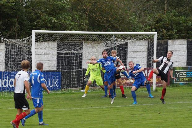 Nathan Cloudsdale, right, in goalmouth action against Droylsden