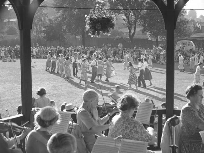 Picture by Joseph Hardman of folk dancing by a bandstand