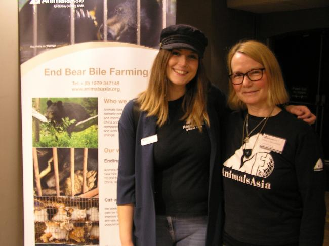Sorrel Coulson (in the cap) and volunteer Maren Dallman in front of the welcoming poster at Kendal's first Vegan Fair at the Brewery Arts Centre at the weekend.