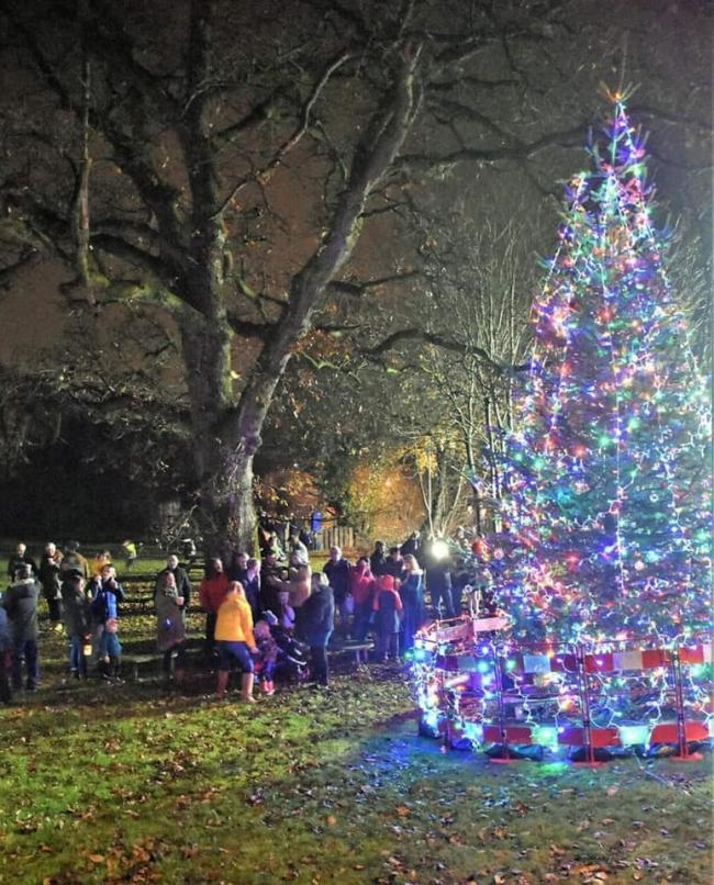 Residents gathered around the Christmas tree in Burneside. Photo: Burneside Residents' Parish Association
