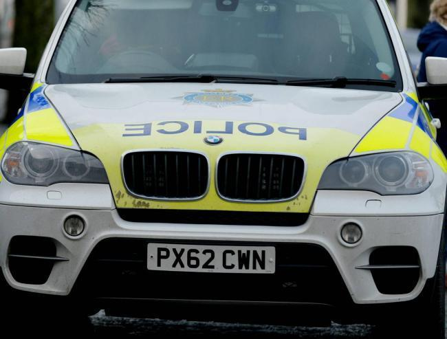 Emergency services at scene of traffic incident on A590