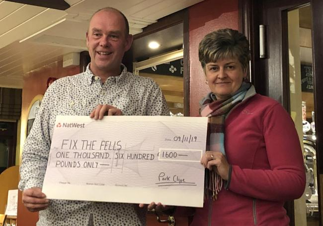Susan Dickson presents the donation to Steve Tonkin of Fix the Fells which doubled the sum with match funding