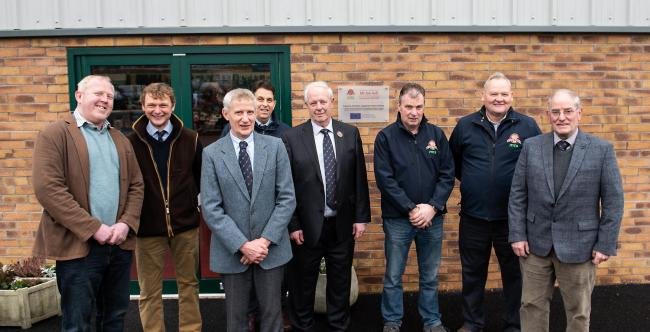 The Aspatria Farmers team at the new premises. From left to right: Mark Lee, John Swainson, William Graham (chairman), Tim Wilson (chief executive), Ian Bell, Leonard Hall, David Wright and Richard Miller