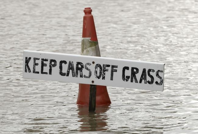 Still danger: The Environment Agency still has a flood warning and two alerts in place. Photo: Danny Lawson/PA Wire.