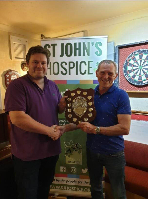 WINNER: Tony Newell, left, being presented the trophy after he defeated Steve Brewer 3-1 in the final