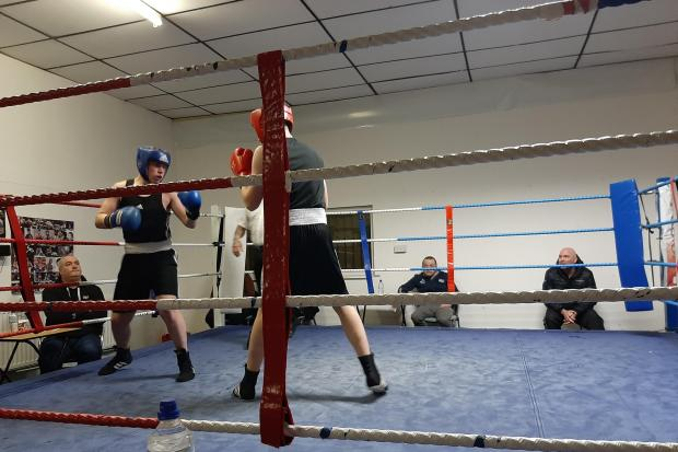 Kendal boxer Reece Johnson (blue head guard) in action in Morecambe on Saturday night.