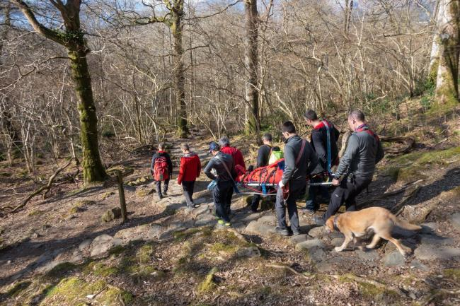 RESCUE: KMRT members carrying the injured man. Picture: Stuart Holmes/Keswick Mountain Rescue Team