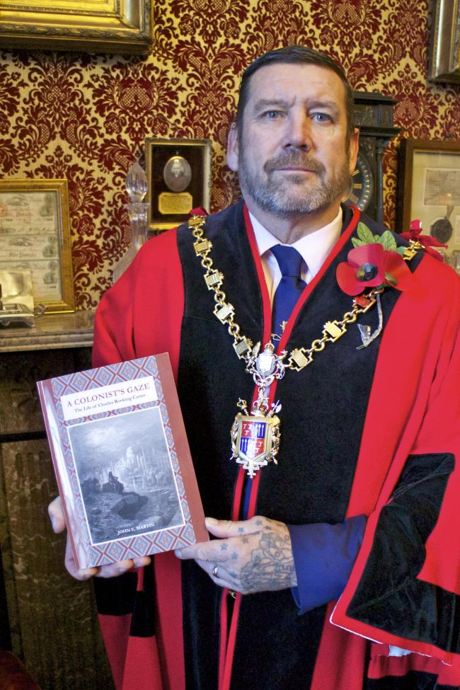 []: Kendal mayor Alvin Finch with a copy of the recently-published Charles Rooking Carter biography