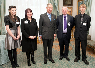 ROYAL APPOINTMENT: With Prince Charles at Clarence House are, from left, are Laura Moses, Tammy Nicholls, head teacher Denis Fay and Ross Callow from Ulverston Victoria High School