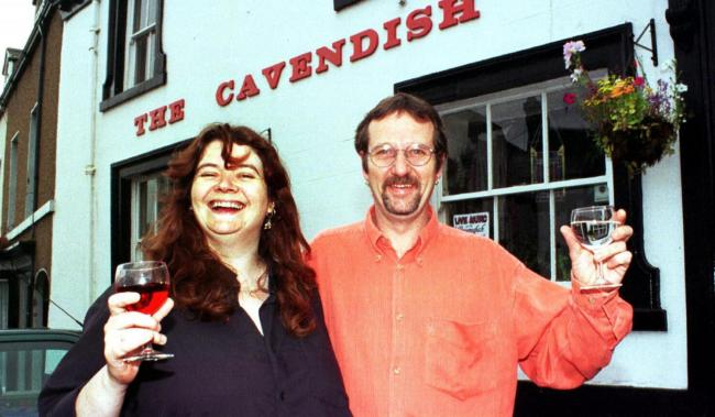 RAISE A GLASS: New licensees Ian Atkinson and Donna Stokes outside The Cavendish Arms, Dalton, in July 1999