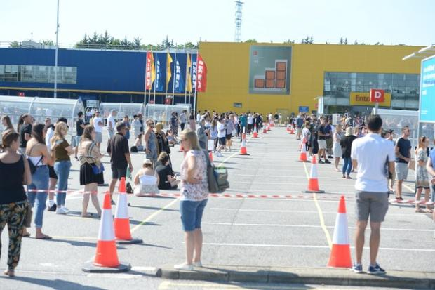 The Westmorland Gazette: Customers queued two metres apart to get inside Ikea in Lakeside, Essex. Picture: Nick Ansell/PA Wire