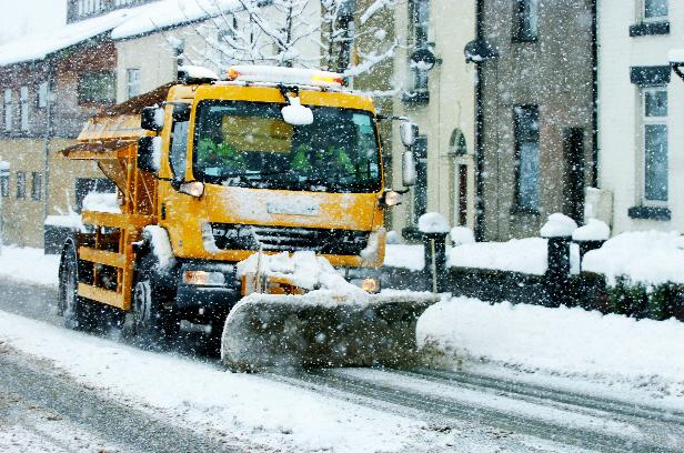 The Westmorland Gazette: PLOUGHING ON: A snow plough and gritter helps to clear roads in Bolton