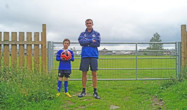 Paul and Billy Park standing by one of the gates which were put in by Ibis and Kendal united