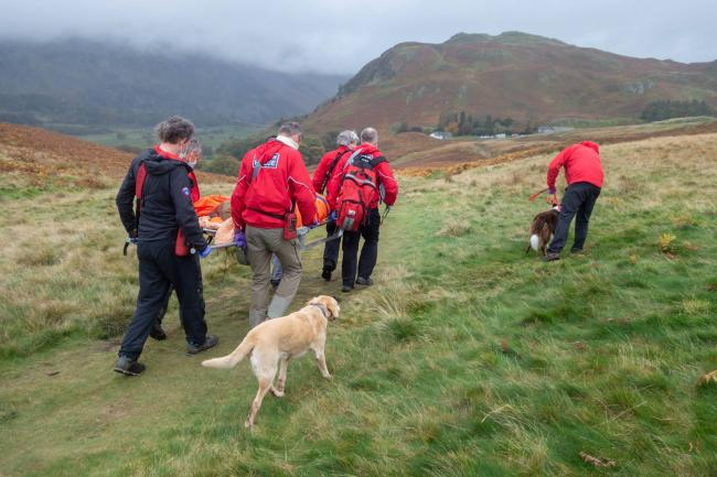 RESCUE: The team taking the woman down to the waiting ambulance     Picture: Keswick Mountain Rescue Team