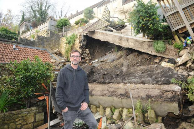 The Westmorland Gazette: RUBBLE: Damien Weddell at his newly purchased home in Bradford on Avon where his garden wall has collapsed