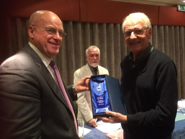 TRIBUTES: President of Ambleside Sports, Geoff Atkinson, presents an award to Pete Bland