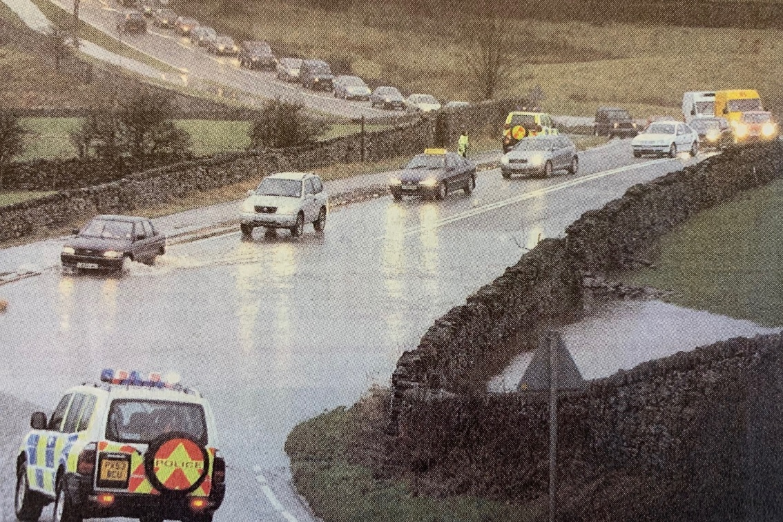 DISRUPTION: Police control the flow of traffic to get round the flood on the A591 at Bannerigg