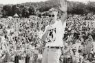 DJ: Radio 1's Simon Mayo in 1990 in front of the crowd at the roadshow on the Glebe at Bowness