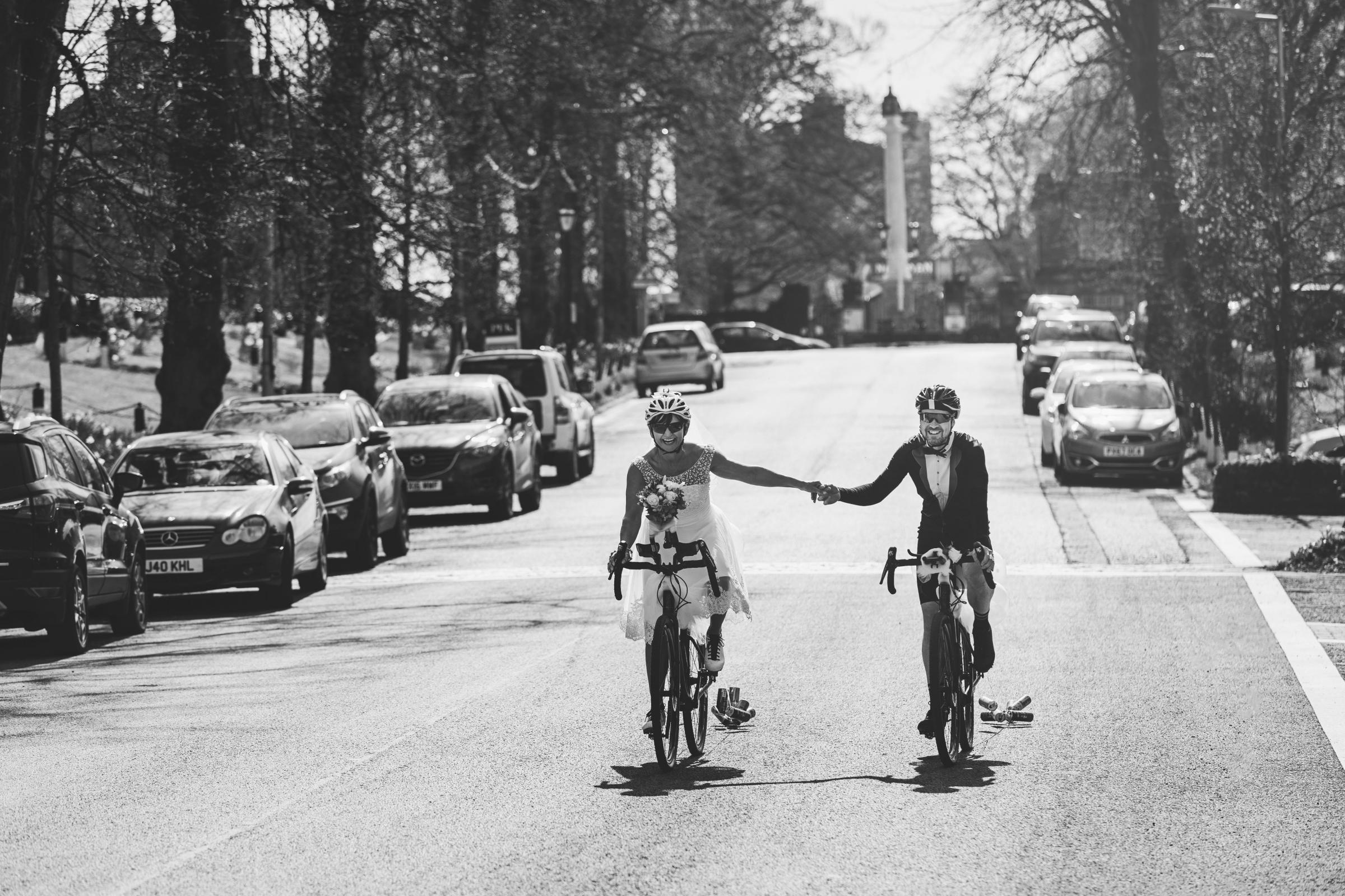 I DO: Chris and Sharon Bower felt like Tour de France heroes after wedding in their cycling gear. Photos by Tiree Dawson