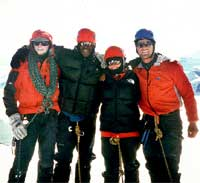 South Lakes mountaineering guide Robin Beadle; TV celebrity Ian Wright; travel companion Novello Noades and Lakes mountain instructor Nigel Edwards on summit of Greenland's Gunnbjornsfjeld. Photo from Keith Partridge.