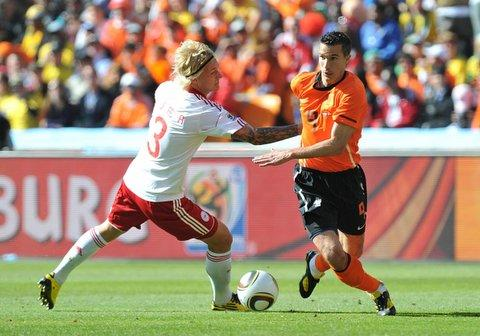 Holland striker Robin van Persie takes on Denmark opponent Simon Kjaer
