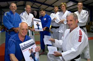Kendal Judo Club members signing up to the organ donor campaign