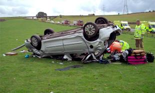 CRASH SITE: Paramedics at the scene of the accident near the Shap turnoff