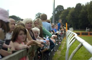 DAY AT RACE: Punters watch the horses