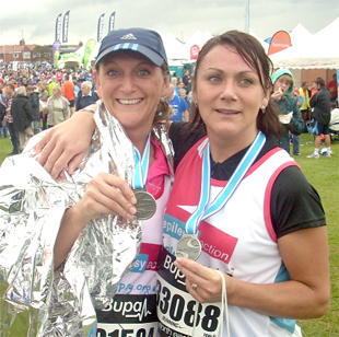 RUNNING TOTAL: Andrea king and sister Hayley pictured at the end of the Great North Run in September in one of their many fundraising efforts