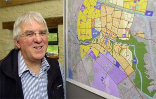 REBUILDING: Derrick Hartley, with a map of the city