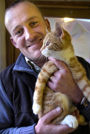 John Edmondson with a kitten from Eden Animal Rescue.