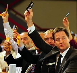 VOTE Tim Farron (middle) sat behind Nick Clegg (right) at the Lib Dem conference today