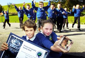 DOUBLE ACT: Hawkshead Esthwaite Primary school pupils, Jamie Prier and Charlotte Mallett and Class with the international award and an excellence in geography award