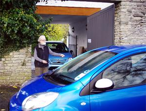 STUCK: Graham Mathews showing his garage blocked in by a 'legally parked' car.