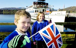 COUP: Heron Hill's Sam Tattersall and Ellie Maplethorpe prepare to welcome the Olympic torch
