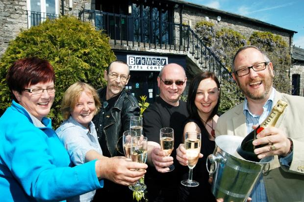 Brewery chief executive Richard Foster with some of the Kendal arts centre's long-serving members of staff