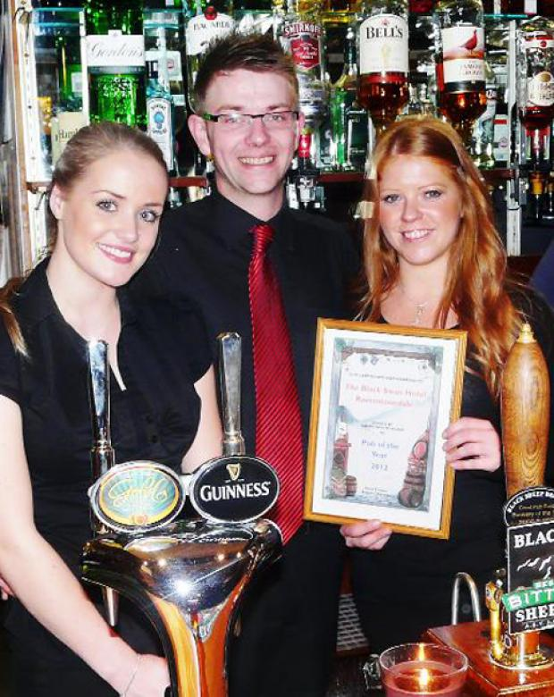 Black Swan staff being given their award by a CAMRA official
