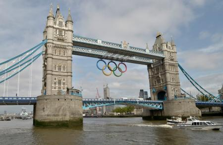 The Olympic Rings hang from Tower Bridge to mark one month to go to London 2012...