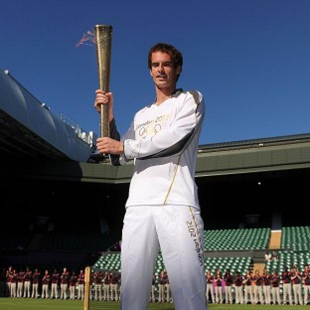 Andy Murray carries the Olympic Flame at Wimbledon
