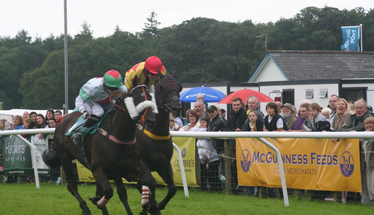 Pete, ridden by Lucy Alexander, just pips Jason Maguire aboard Red Kingdom to victory