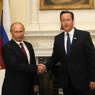 Prime Minister David Cameron and Russia's President Vladimir Putin discussed Syria and bilateral trade when they met at Number 10