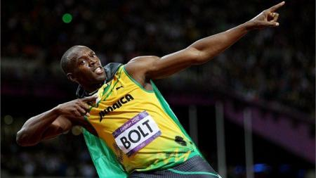 Jamaica's Usain Bolt celebrates after winning the 100m crown....