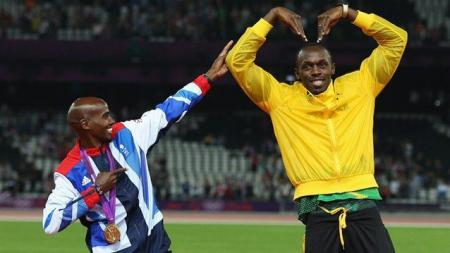 Image of the games: Mo Farah and Usain Bolt swap poses...