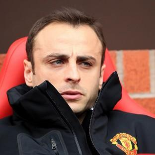 Dimitar Berbatov's proposed move to Fulham is far from certain, says Sir Alex Ferguson