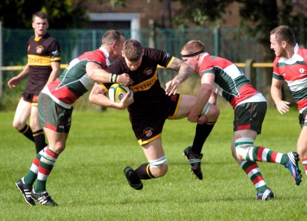A Kendal player is stopped in his tracks in the tight victory over Waterloo